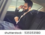 man in the car reading and... | Shutterstock . vector #535353580