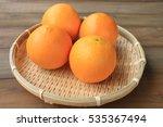Four Orange In Threshing Baske...