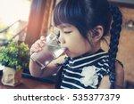 little girl drinking water | Shutterstock . vector #535377379