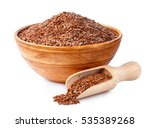 Stock photo flax seeds or linseed in wooden scoop and in clay bowl isolated on white background 535389268