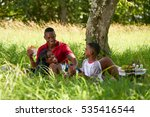 happy black couple with son in... | Shutterstock . vector #535416544
