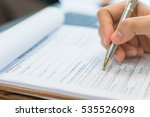 hand with pen over application... | Shutterstock . vector #535526098