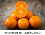 Orange On A Wood Background