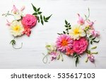 Stock photo festive flower composition on the white wooden background overhead view 535617103