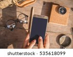 phone in hand and a compass....   Shutterstock . vector #535618099