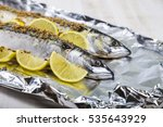 raw mackerel in foil close up.... | Shutterstock . vector #535643929