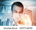 young scientist mixing reagents ... | Shutterstock . vector #535714690