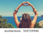 girl holding a heart shape for... | Shutterstock . vector #535725940