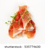 slices of air dried ham with... | Shutterstock . vector #535774630