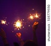 Sparklers Burn In People Hands...