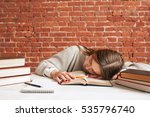 tired student sleeping on book... | Shutterstock . vector #535796740