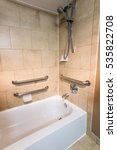 Small photo of Disability Access Bathtub Shower in a Hotel Room with Grab Bar Hand Rails