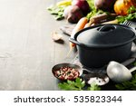 cast iron pot and vegetables on ... | Shutterstock . vector #535823344