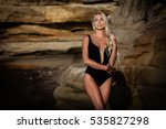 sexy blond girl in black bikini ... | Shutterstock . vector #535827298