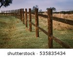 Long Rustic Wooden Fence In Th...