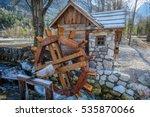 Wooden Water Wheel On A Creek...