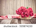 Stock photo flowers bouquet of red roses with heart of marble on wooden table vintage valentine floral 535874233