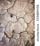 Small photo of Dry, cracked clay soil Texture, background, seamless pattern. crack in the ground, drought, sun. absence of water.art
