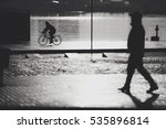 BARCELONA, SPAIN - DECEMBER 25, 2015: Christmas morning, cyclist silhouette - stock photo