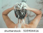 woman washing her head in the...   Shutterstock . vector #535904416