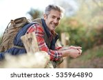 hiker relaxing by fence on...   Shutterstock . vector #535964890