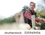 hiker relaxing by fence on... | Shutterstock . vector #535969456