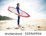 surfer on the beach holding... | Shutterstock . vector #535969954