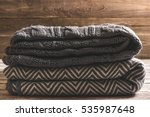 a neat pile of knitted warm... | Shutterstock . vector #535987648