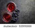 two glasses of red wine and... | Shutterstock . vector #535993000