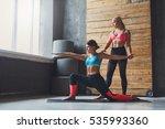 yoga instructor helps beginner... | Shutterstock . vector #535993360