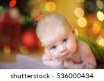 baby  lies on a white cover in... | Shutterstock . vector #536000434
