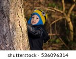 happy child plays in the forest | Shutterstock . vector #536096314