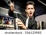 Stock photo flair bartender in action 536123983