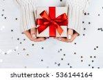 female hands holding present... | Shutterstock . vector #536144164