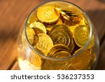 a lot of gold coins in a glass... | Shutterstock . vector #536237353