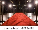 Long red carpet between rope...