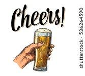 female hand holding a full beer ... | Shutterstock .eps vector #536264590