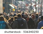 crowd of people walking on a...