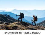 silhouettes of two hikers... | Shutterstock . vector #536350000