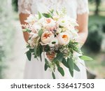 Wedding bouquet in bride's...