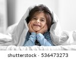 cute little girl lying on bed... | Shutterstock . vector #536473273
