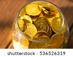 a lot of gold coins in a glass... | Shutterstock . vector #536526319