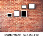 brick wall with photo frames... | Shutterstock . vector #536558140