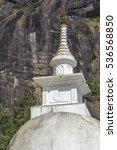 Small photo of White Stupa sacred mountain Adam's Peak in Sri Lanka