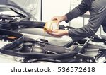 car mechanic replacing and... | Shutterstock . vector #536572618
