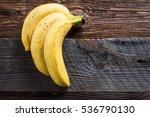 3 Bananas With Dark Spots On...