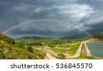 Rainbow On Dam And Mountain...