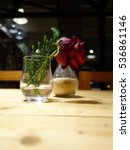 a rose in a glass on the table   Shutterstock . vector #536861146