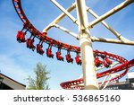 people ride in red carrieges on ... | Shutterstock . vector #536865160