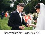 the groom wear a wedding ring...   Shutterstock . vector #536895700